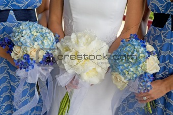 Bride and Two Bridesmaids Holding Bouquets