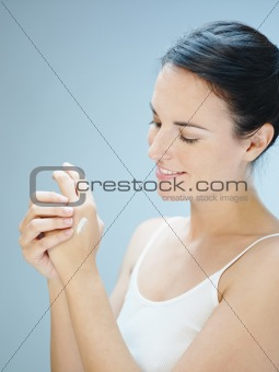 woman massaging hands