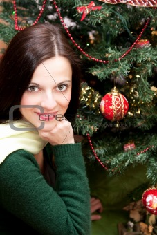 Beautiful brunette by the Christmas tree
