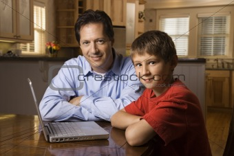 Man and Young Boy with Laptop