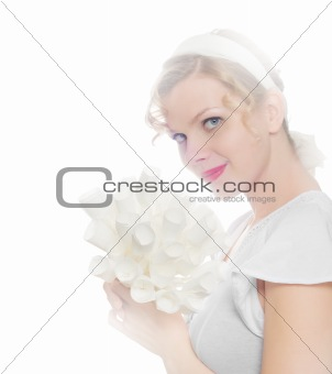 brightly lit beautiful blonde girl with a bouquet of white paper