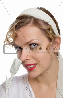 beautiful blonde girl smelling at a single white paper rose