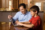 Man and Young Boy on Laptop