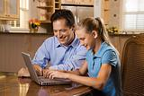 Man and Girl Working on Laptop