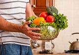 Man Holding Bowl of Vegetables