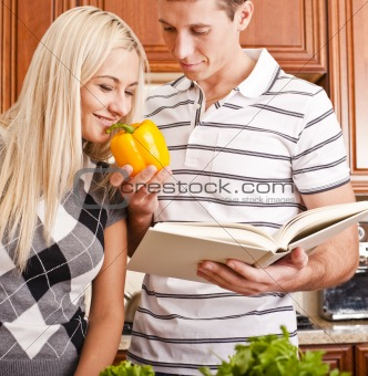 Young Woman Smelling Pepper Held by Young Man