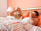 Young Couple Waking Up in Bed
