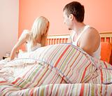 Young Couple Sitting Up in Bed