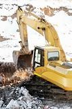 loader excavator in open cast in winter