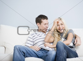 Affectionate Couple Laughing and Relaxing on Couch