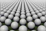 Hundreds of golf balls lined up on a meadow