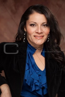 Attractive Hispanic Woman Poses for an Inside Studio Portrait.