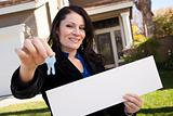 Happy Attractive Hispanic Woman Holding Blank Sign and Keys in Front of House.