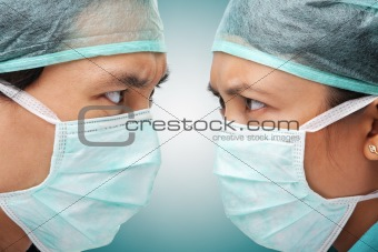 Serious looking between two medical worker