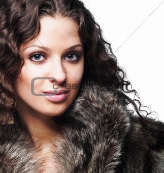 Beautiful woman wearing furs isolated on white