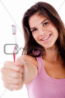 beautiful young woman holding toothbrush and smiling