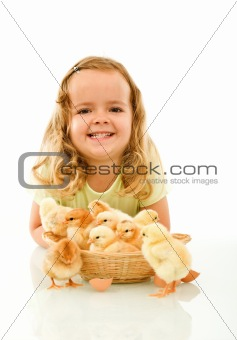 Happy girl with her Easter baby chickens