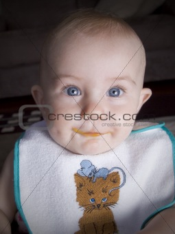 Baby with food on lips