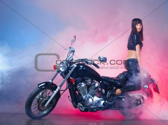 Beautiful girl on a motorcycle