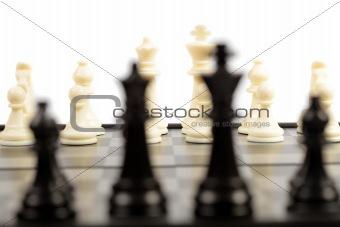Black chessmen on a chessboard