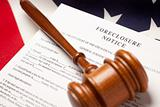 Gavel, American Flag and Forclosure Notice with Selective Focus.