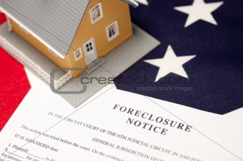 Foreclosure Notice and House on the American Flag with Selective Focus.