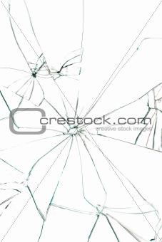 Broken glass with black cracks