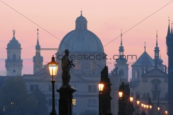 prague - charles bridge and spires of the old town at dawn