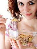 Young people eating milk with cereals