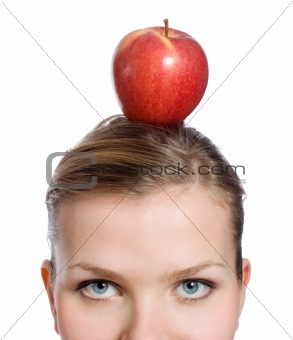 blonde woman with a red apple on her head