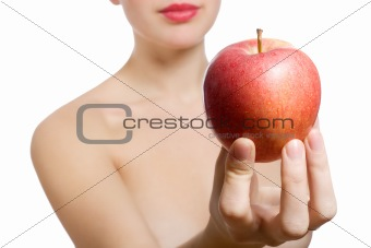 beautiful young blonde woman offering red apple