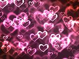 Abstract glowing Hearts on a colorful background