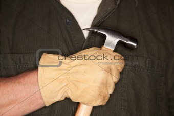 Caucasian Man with Leather Construction Glove Holding Hammer.