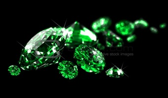 Emeralds on black surface