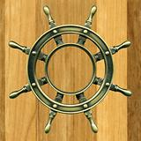 bronze wheel on a wooden board, close-up photography