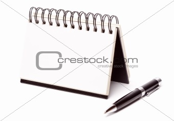 Blank Spiral Note Pad and Pen Isolated on White.