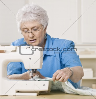 Older Woman Sewing