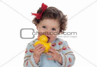 Beautiful blue-eyed baby sucking a rubber duck isolated
