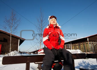 female snowboarder over blue sky in park