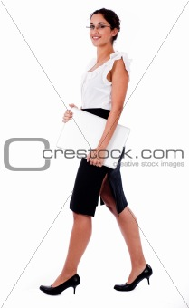 Business women walking with laptop