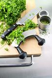 Fresh chopped parsley with cutting board