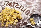 Fresh, raw tortellini with flour