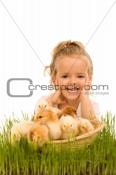 Little girl with a basket full of small chickens