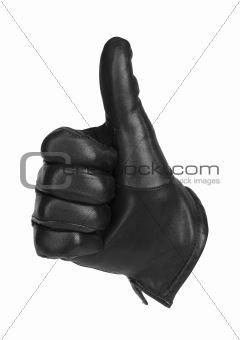 a black glove making the gesture of thumbs up