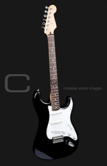Black rock guitar isolated on dark gray