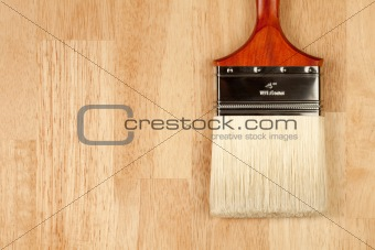 Paint Brush on a Wood Surface with Copy Room.