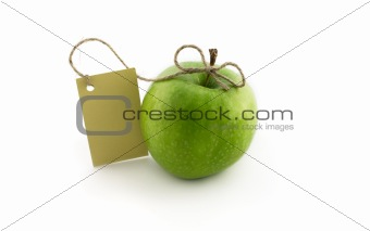 Green apple with card