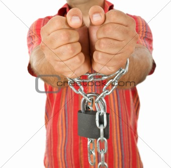 Man in chains - closeup, focus on hands