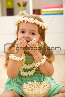 Little girl eating popcorn