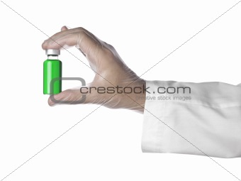 Green vial on a hand